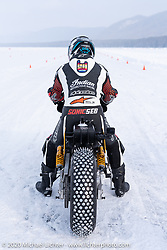 Pilot Sebastien Lorentz of Lucky Cats Garage in Chartres, France on Belgian custom bike builder Brice Hennebert's 2018 Indian Scout Bobber at the Baikal Mile Ice Speed Festival. Maksimiha, Siberia, Russia. Thursday, February 27, 2020. Photography ©2020 Michael Lichter.