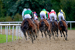 Runners and riders compete in the Download The At The Races App Nursery at Wolverhampton racecourse. Picture date: Monday October 11, 2021.