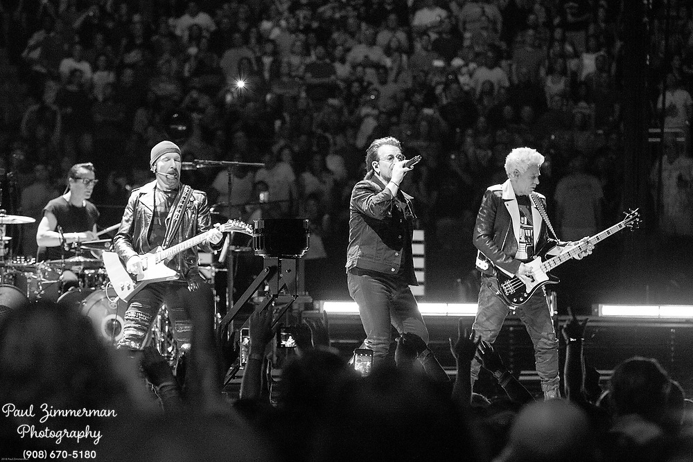 NEWARK, NJ - JUNE 29:  (EDITORS NOTE: Image has been converted to black and white)  (L to R) The Edge, Larry Mullen, Jr., Bono, and Adam Clayton of U2 perform onstage during the eXPERIENCE + iNNOCENCE TOUR at Prudential Center on June 29, 2018 in Newark, New Jersey.  (Photo by Paul Zimmerman/Getty Images) *** Local Caption *** The Edge; Larry Mullen; Jr.; Bono; Adam Clayton