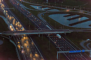 Nederland, Noord-Holland, Amsterdam, 16-01-2014; A2 bij zonsondergang, afslag Abcoude. Foto richting Utrecht. Het woonwerkverkeer in de avondschemering. <br /> Motorway A2 at sunset, exit Abcoude. Utrecht at the far away horizon. Commuter traffic at dusk.<br /> aerial photo (additional fee required);<br /> copyright foto/photo Siebe Swart.