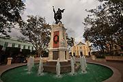 Christopher Columbus statue and Cathedral of Nuestra Senora de la Candelaria in Plaza Colon, Mayaguez Puerto Rico