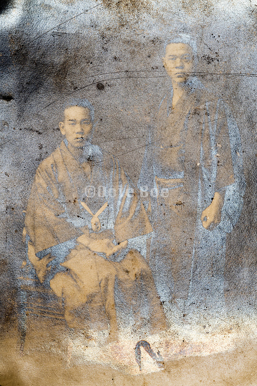 extreme deteriorating studio portrait of father and adult son Japan ca 1930s