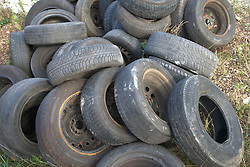 Fly tipping of old car tyres,