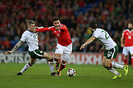 Hal Robson-Kanu of Wales © is challenged by James McClean (l) and Harry Arter of Republic of Ireland . Wales v Rep of Ireland , FIFA World Cup qualifier , European group D match at the Cardiff city Stadium in Cardiff , South Wales on Monday 9th October 2017. pic by Andrew Orchard, Andrew Orchard sports photography