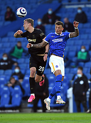 West Ham United's Tomas Soucek (left) and Brighton and Hove Albion's Ben White battle for the ball during the Premier League match at the American Express Community Stadium, Brighton. Picture date: Saturday May 15, 2021.