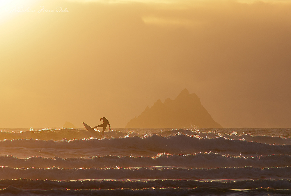 Surfer at St. Finian's Bay near Skellig Michael, County Kerry, Ireland ****** <br /> <br /> Visit & browse through my Photography & Art Gallery, located on the Wild Atlantic Way & Skellig Ring between Waterville and Ballinskelligs (Skellig Coast R567), only 3 minutes from the main Ring of Kerry road.<br /> https://goo.gl/maps/syg6bd3KQtw<br /> <br /> ******<br /> <br /> Contact: 085 7803273 from an Irish mobile phone or +353 85 7803273 from an international mobile phone