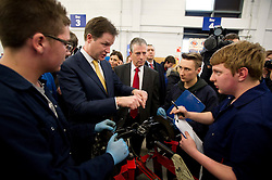© London News Pictures. 11/02/2013 . Eastleigh, UK.  Leader of the Liberal Democrat Party, NICK CLEGG (centre left)  with the Liberal Democrat part candidate for the Eastleigh by-election MIKE THORNTON (centre right) speaking to automotive studies students during a visit to Eastleigh College in Eastleigh, Hampshire on February 11, 2013. The by-election was called when the former MP for Eastleigh, Chris Hune, resigned after admitting perverting the course of justice. Photo credit : Ben Cawthra/LNP