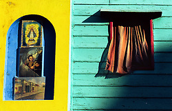 BUENOS AIRES, ARGENTINA:  Images hang on a wall in the the residental area of  La Boca in Buenos Aires, Argentina. The area of La Boca is known for it's European influence. .(Photo by Ami Vitale)