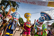 """28 JUNE 2014 - DAN SAI, LOEI, THAILAND: """"Ghosts"""" in Dan Sai during the ghost festival parade. Phi Ta Khon (also spelled Pee Ta Khon) is the Ghost Festival. Over three days, the town's residents invite protection from Phra U-pakut, the spirit that lives in the Mun River, which runs through Dan Sai. People in the town and surrounding villages wear costumes made of patchwork and ornate masks and are thought be ghosts who were awoken from the dead when Vessantra Jataka (one of the Buddhas) came out of the forest.    PHOTO BY JACK KURTZ"""