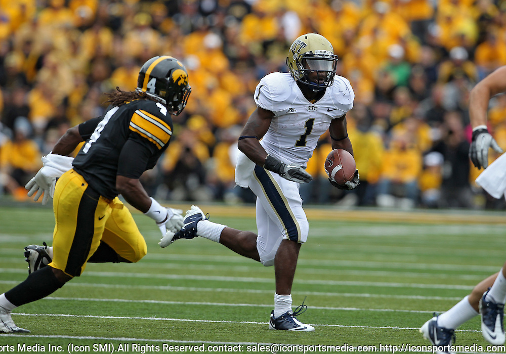 September 17, 2011: Pittsburgh Panthers running back Ray Graham (1) tries to get around Iowa Hawkeyes defensive back Jordan Bernstine (4) during the second half of the game between the Iowa Hawkeyes and the Pittsburgh Panthers at Kinnick Stadium in Iowa City, Iowa on Saturday, September 17, 2011. Iowa defeated Pittsburgh 31-27.