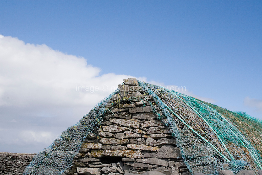 Stone shed with fishing nets drying on Inis Oirr Island the Aran Islands County Galway Ireland