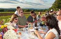 "Trudy and Marty Pelletier enjoy appetizers served during Beans and Greens ""Farm to Table Dinner in the Field"" Wednesday evening.  (Karen Bobotas/for the Laconia Daily Sun)"