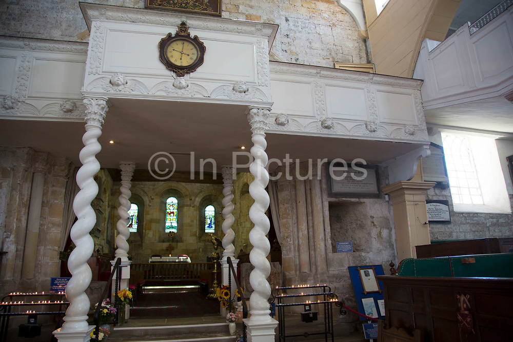 St Mary's Church in Whitby, North Yorkshire. A mixture of Medieval to Georgian and much inbetween. The interior is a jumble of architectural styles and influences. Situated on the east coast at the mouth of the River Esk. Tourism started in Whitby during the Georgian period and developed. Its attraction as a tourist destination is enhanced by its proximity to the high ground of the North York Moors, its famous abbey, and by its association with the horror novel Dracula. Yorkshire, England, UK.