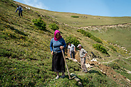 Esma Civelek, centre,  in Alaca Yaylası, helping to dig a well in her home village up in the Pontic mountains, where communicating via whistling is common, due to the large distances between homes, and the mountainous landscape.