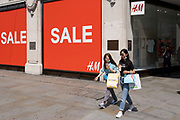 As some non-essential shops re-open with sales on, shoppers return to Oxford Street while social distancing measures are put in place by the various retail shops which are open on 26th June 2020 in London, England, United Kingdom. As the July deadline approaces and government will relax its lockdown rules further, the West End remains quiet, apart from this popular shopping district, which itself has far fewer people on its pavements than normal.
