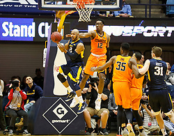 Feb 10, 2018; Morgantown, WV, USA; West Virginia Mountaineers guard Jevon Carter (2) drives down the lane and passes during the first half against the Oklahoma State Cowboys at WVU Coliseum. Mandatory Credit: Ben Queen-USA TODAY Sports
