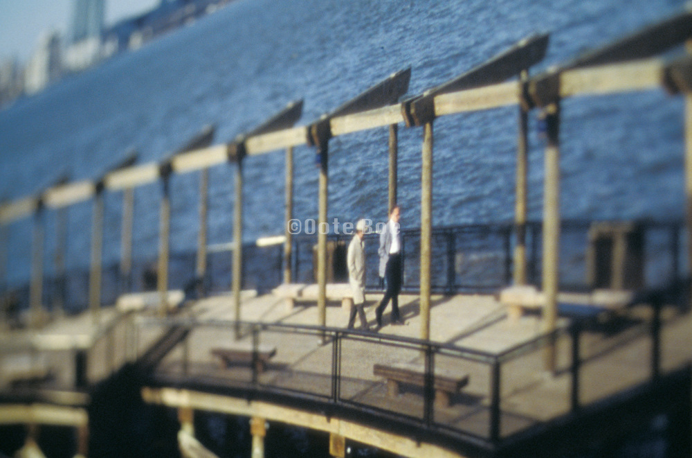 Two people walking on a pier
