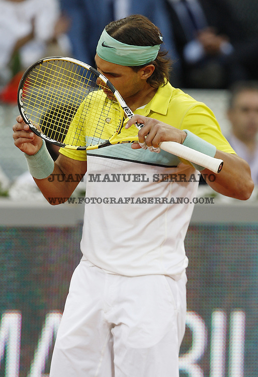 15 May 2009, Madrid --- Rafael Nadal of Spain check his racket during the ATP 1000 Mutua Madrilena Madrid Open at the Magic Box stadium in Madrid, Spain. Photo byJuan Manuel Serrano --- Image by ©Juan Manuel Serrano