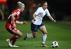 England Women's Fran Kirby (right) and Wales Women's Rhiannon Roberts battle for the ball
