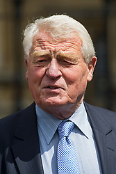 © Licensed to London News Pictures. 03/06/2015. London, UK.  Former Leader of the Liberal Democrats Lord PADDY ASHDOWN leaving the lords entrance to the Houses of Parliament following a tribute session in parliament for the late Liberal Democrat MP, Charles Kennedy, who died early this week. Photo credit: Ben Cawthra/LNP