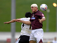 Photo: Daniel Hambury.<br />Northampton Town v Swansea City. Coca Cola League 1. 28/10/2006.<br />Northampton's Chris Doig battles despite a blood injury to his head.
