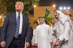 Saudi King Salman Bin Abdelaziz (or Abdul Aziz) Al Saud (right) dances the 'ardha' or traditional sword dance with US President Donald Trump in Riyadh, Saudi Arabia on May 20, 2017. This is the first US president's visit abroad. Photo by Balkis Press/ABACAPRESS.COM