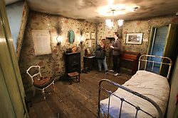 © Licensed to London News Pictures. 04/10/2015. London, UK. Visitors look at recreation of one of the victims bedrooms inside the Jack the Ripper Museum.  A planned protest was cancelled at the museum today. Photo credit: Peter Macdiarmid/LNP