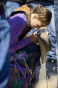 """Bailee Long, 12, says a prayer behind the bucking chutes at the last Jackson Hole Rodeo of the summer Saturday before climbing atop a """"mini-bull"""" named Snicker Jacket. Long didn't score on the ride but still earned a roaring applause from the crowd."""