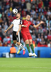 Martin Harnik of Austria competes for the high ball with Pepe of Portugal  - Mandatory by-line: Joe Meredith/JMP - 18/06/2016 - FOOTBALL - Parc des Princes - Paris, France - Portugal v Austria - UEFA European Championship Group F
