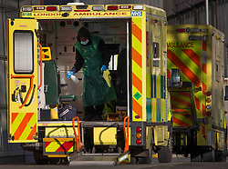 © Licensed to London News Pictures.21/01/2021, London,UK. A hospital worker prepares an ambulance for the next call out at the Royal London Hospital in east London as the third national lockdown continues and hospitals are struggling to cope with the number of admissions. Photo credit: Marcin Nowak/LNP