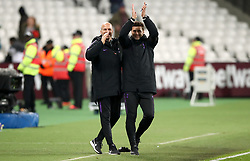 Tottenham Hotspur manager Mauricio Pochettino (right) applauds the fans at the end of the Carabao Cup, Fourth Round match at the London Stadium.