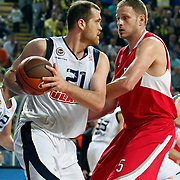 Fenerbahce Ulker's Oguz SAVAS (L) and Olympiacos's Rasho NESTEROVIC (R) during their Euroleague Basketball Top 16 Game 5 match Fenerbahce Ulker between Olympiacos at Sinan Erdem Arena in Istanbul, Turkey, Thursday, February 24, 2011. Photo by TURKPIX
