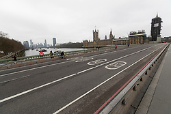 © Licensed to London News Pictures. 19/03/2020. London, UK. Westminster Bridge appears quiet this afternoon . New cases of the COVID-19 strain of Coronavirus are being reported daily as the government outlines it's plans for controlling the outbreak. Photo credit: George Cracknell Wright/LNP