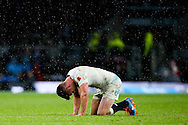 England's Owen Farrell down after taking a fist in the face from his opposite number New Zealand's Aaron Cruden - QBE Autumn Internationals - England vs New Zealand - Twickenham Stadium - London - 08/11/2014 - Pic Charlie Forgham-Bailey/Sportimage