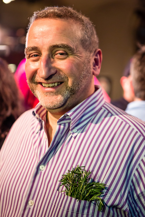 Flushing, NY - February 25, 2017. Cesare Casella, one of the judges for the 2017 Charcuterie Masters at Flushing Town Hall, with a spring of rosemary in his shirt pocket.
