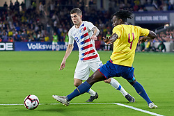 March 21, 2019 - Orlando, FL, U.S. - ORLANDO, FL - MARCH 21: United States midfielder Christian Pulisic (10) battles with Ecuador defender Juan Carlos Paredes (4) in game action during an International friendly match between the United States and Ecuador on March 21, 2019 at Orlando City Stadium in Orlando, FL. (Photo by Robin Alam/Icon Sportswire) (Credit Image: © Robin Alam/Icon SMI via ZUMA Press)