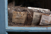 Herbs in the window of abandoned Herbalist Shop, Rethymno, Crete owned, apparently, by Panajiotis and or Dimitrios Kontogianis.