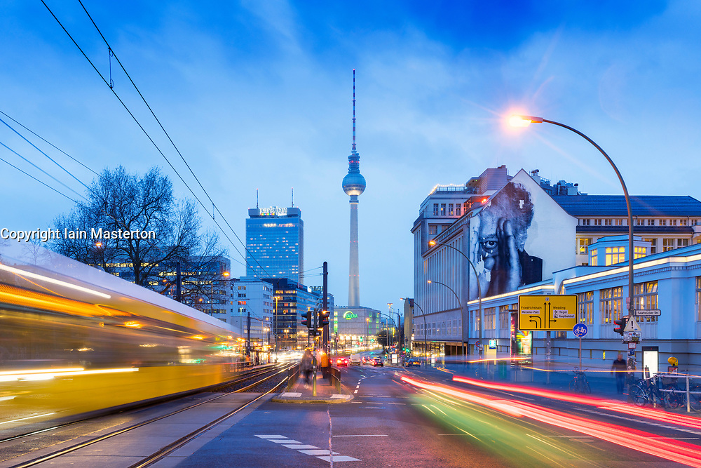Night cityscape view of Berlin with Television Tower and Tram in Mitte , Berlin, Germany