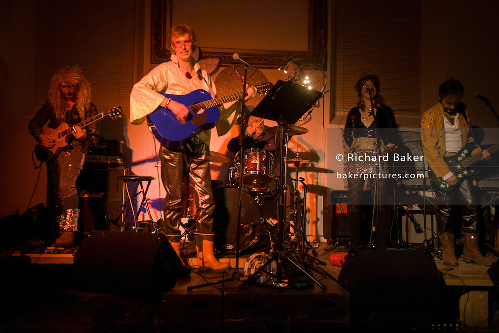 A glam rock David Bowie tribute band perform the entire 'Ziggy Stardust' album at a private party in Wales.