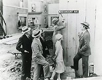 1926 Jesse Lasky (right) watches as an actress nails in the Paramount Ave. street sign at the new Famous Player Lasky Studio on Marathon St.