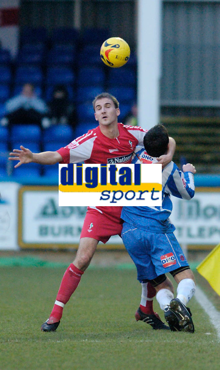 Photo: Leigh Quinnell.<br /> Hartlepool United v Swindon Town. Coca Cola League 1.<br /> 02/01/2006. Swindons Andrew Nicholas has a graple hold on Hartlepools Chris Llewellyn.