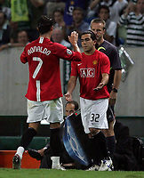 Photo: Paul Thomas.<br /> Sporting Lisbon v Manchester United. UEFA Champions League Group F. 19/09/2007.<br /> <br /> Goal scorer Cristiano Ronaldo (7) of Utd comes off for Carlos Tevez.
