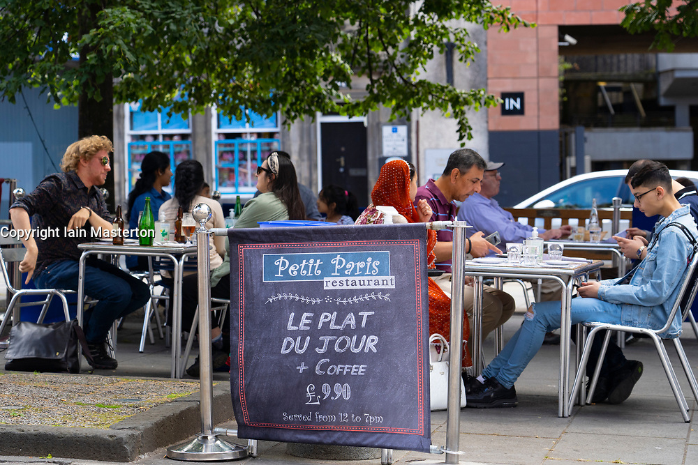 Edinburgh, Scotland, UK. 12 July, 2020, Business slowly returning to normal in Edinburgh city centre. Tourists still almost non existent and streets remain very quiet in the Old Town. Outdoor eating at Petit Paris restaurant in The Grassmarket is busy. Iain Masterton/Alamy Live News