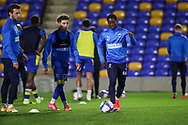 AFC Wimbledon defender Paul Osew (37) warming up prior to kick off during the EFL Sky Bet League 1 match between AFC Wimbledon and Gillingham at Plough Lane, London, United Kingdom on 23 February 2021.