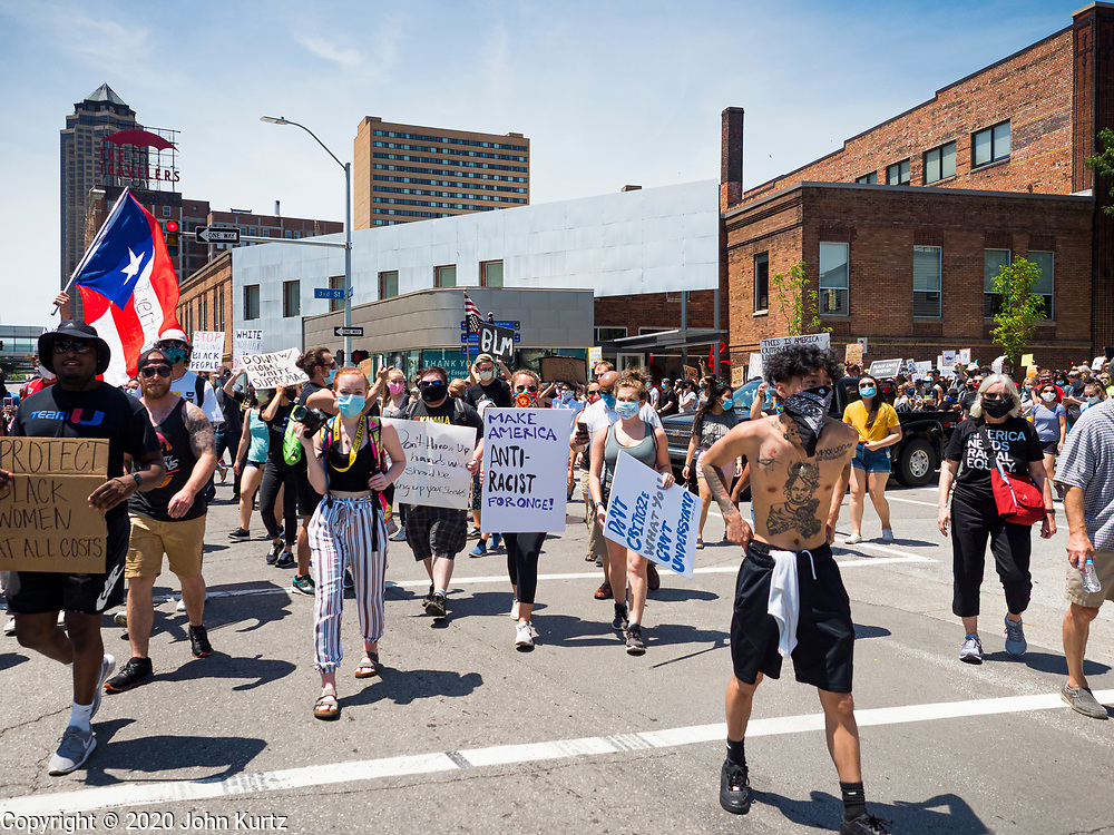 06 JUNE 2020 - DES MOINES, IOWA: People participate in a Black Lives Matter march in downtown Des Moines. More than 1,000 protesters marched through downtown Des Moines to the state capitol to demand an end to police violence against Black people. The march was organized by Black Lives Matter and honored George Floyd, the unarmed Black man killed by Minneapolis police on 25 May 2020.       PHOTO BY JACK KURTZ