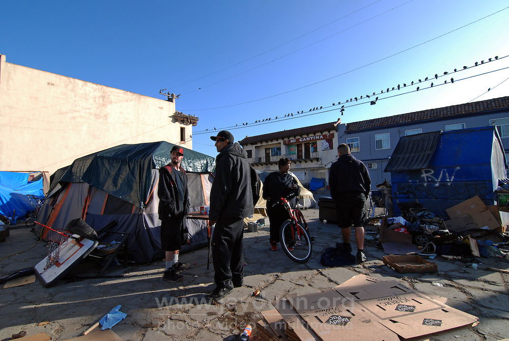Residents stand in the lot in front of 38 Soledad St. on Sunday morning in Salinas.