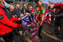 © Licensed to London News Pictures. 24/04/2021. Manchester, UK.  Manchester United fans burn a US flag outside Old Trafford football stadium in Manchester this afternoon. Photo credit:  Ioannis Alexopoulos/LNP