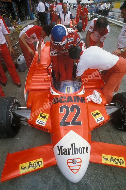Patrick Depailler gets into his Alfa Romeo before the 1980 South African Grand Prix at Kyalami. Photo: Grand Prix Photo