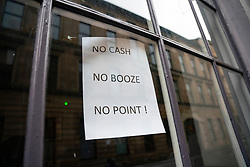 Glasgow, Scotland, UK.1 December 2020. Glasgow remains under level 4 lockdown and non essential businesses, bars and restaurants are closed. Pictured; Sign in window of  Babbity Bowser bar. Iain Masterton/Alamy Live News