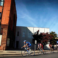 Riders turn off of Hay street and ride past the Markethouse in downtown Fayetteville during the Patriots Criterium Bicycle Race. fom Bike Race
